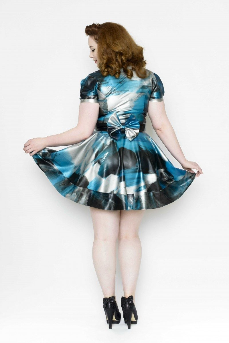 Yummy Gummy Latex, short sleeve blouse and bell bottom skirt with bow belt in blue marble a v