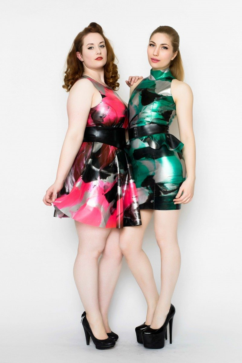 Yummy Gummy Latex High neck dress with peplum belt in green marble and heart back dress with wide pointed belt in uv pink