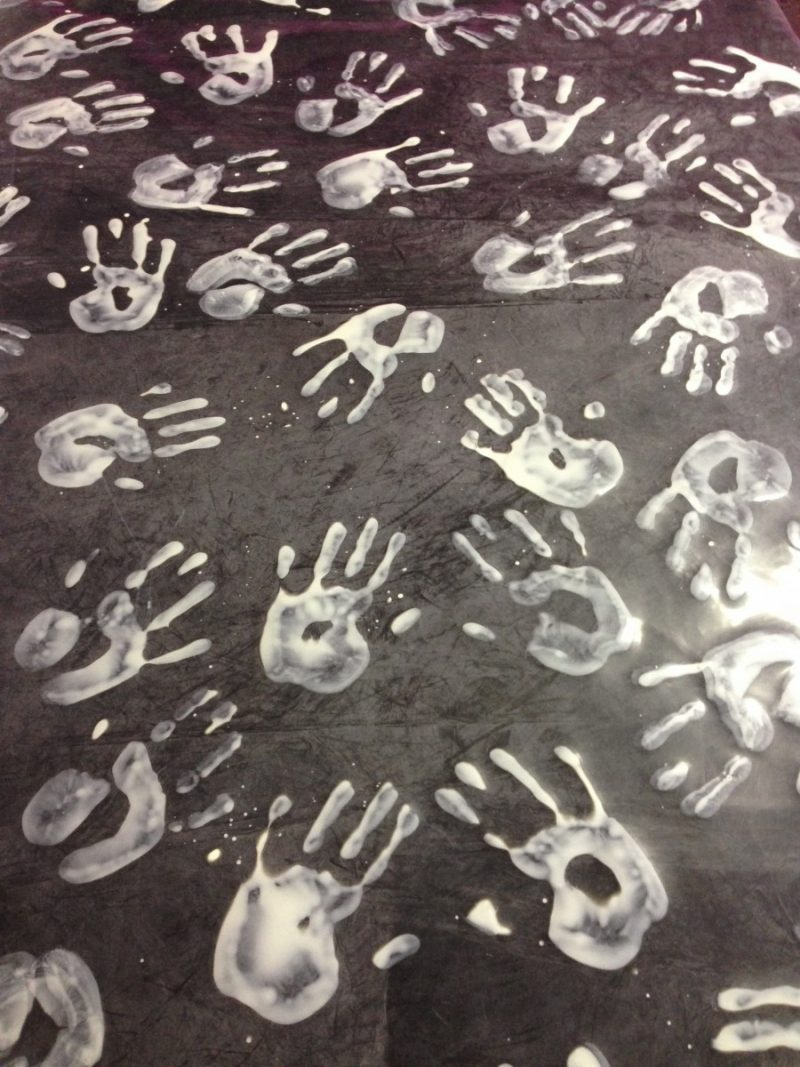 White on black hand print latex